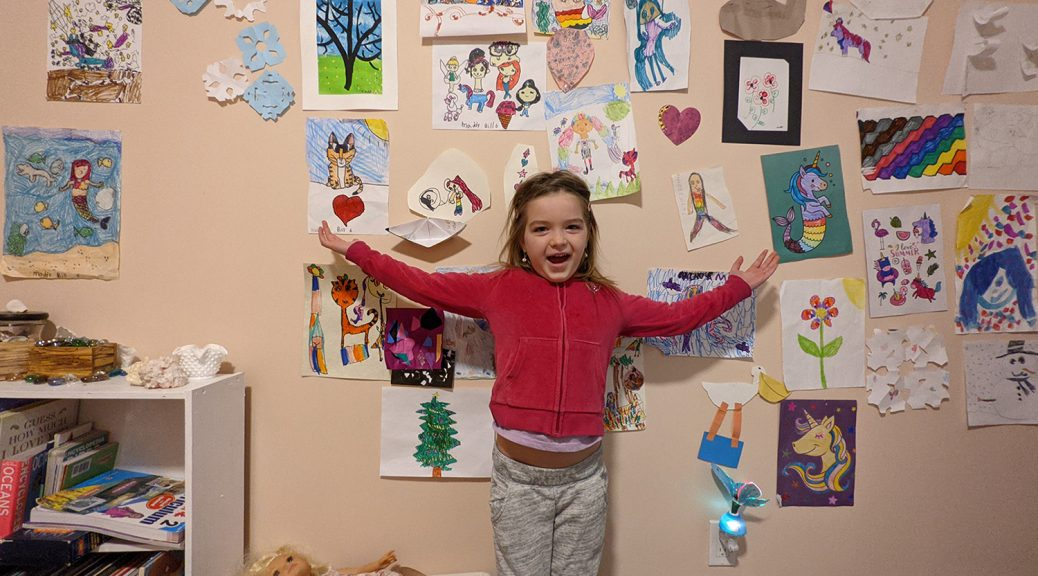 Maddy with her art wall