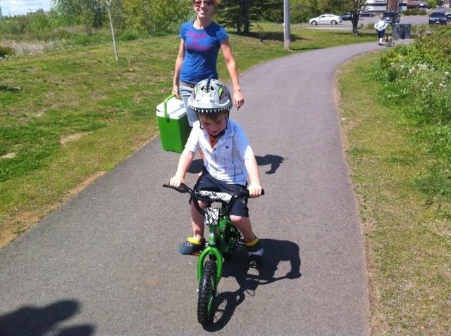 Cameron on his Bike